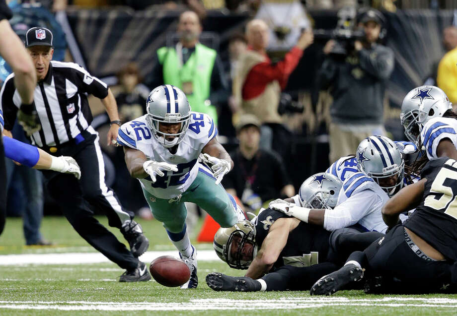 Dallas Cowboys free safety Barry Church (42) dives to recover an insides kick in the second half of an NFL football game against the New Orleans Saints in New Orleans, Sunday, Nov. 10, 2013. (AP Photo/Dave Martin) Photo: Dave Martin, Associated Press / AP