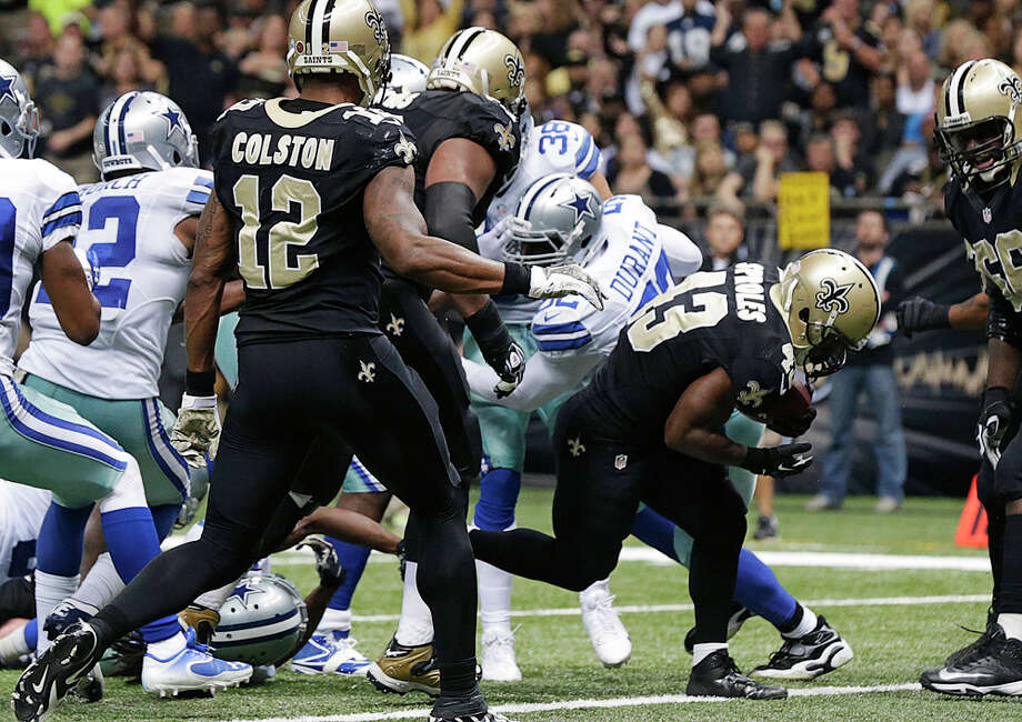 New Orleans Saints running back Darren Sproles (43) carries on a touchdown in the first half of an NFL football game against the Dallas Cowboys in New Orleans, Sunday, Nov. 10, 2013. (AP Photo/Dave Martin) Photo: Dave Martin, Associated Press / AP