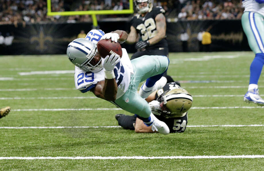 Dallas Cowboys running back DeMarco Murray (29) scores a touchdown in front of New Orleans Saints outside linebacker Will Herring (54) in the first half of an NFL football game in New Orleans, Sunday, Nov. 10, 2013. (AP Photo/Dave Martin) Photo: Dave Martin, Associated Press / AP
