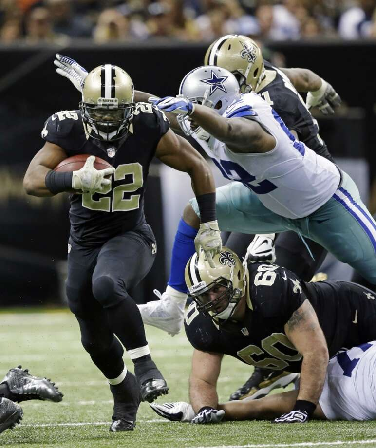 New Orleans Saints running back Mark Ingram (22) rushes past Dallas Cowboys defensive end Jarius Wynn (92) in the second half of an NFL football game in New Orleans, Sunday, Nov. 10, 2013. (AP Photo/Dave Martin) Photo: Associated Press