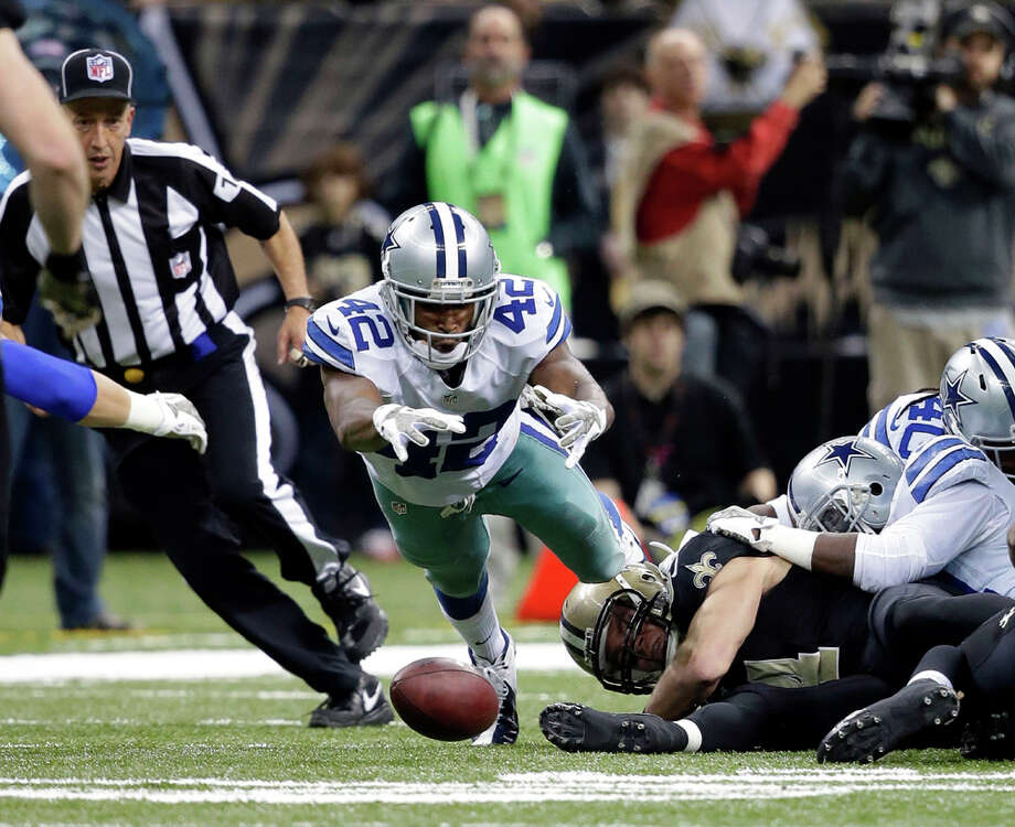 Dallas Cowboys free safety Barry Church (42) dives to recover a kick in the second half of an NFL football game against the New Orleans Saints in New Orleans, Sunday, Nov. 10, 2013. (AP Photo/Dave Martin) Photo: Dave Martin, Associated Press / AP