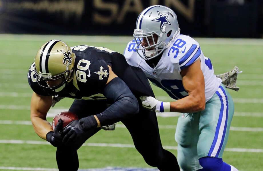 New Orleans Saints tight end Jimmy Graham (80) carries for a first down on a pass play as Dallas Cowboys defensive back Jeff Heath (38) covers in the first half of an NFL football game in New Orleans, Sunday, Nov. 10, 2013. (AP Photo/Bill Haber) Photo: Bill Haber, Associated Press / FR170136 AP