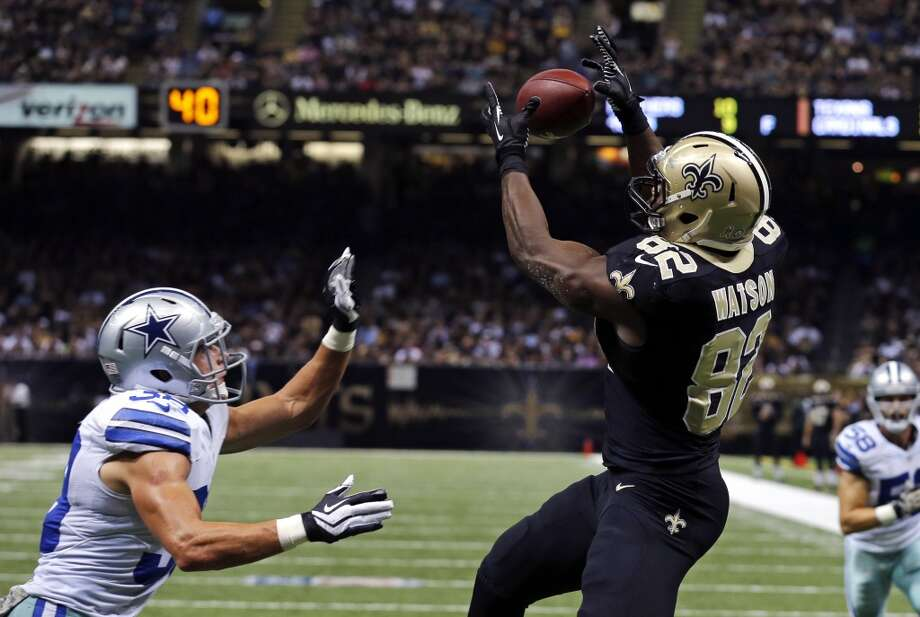 New Orleans Saints tight end Benjamin Watson (82) tries to pull in a pass over Dallas Cowboys defensive back Jeff Heath, left, in the second half of an NFL football game in New Orleans, Sunday, Nov. 10, 2013. Watson was injured on the play. (AP Photo/Bill Haber) Photo: Associated Press