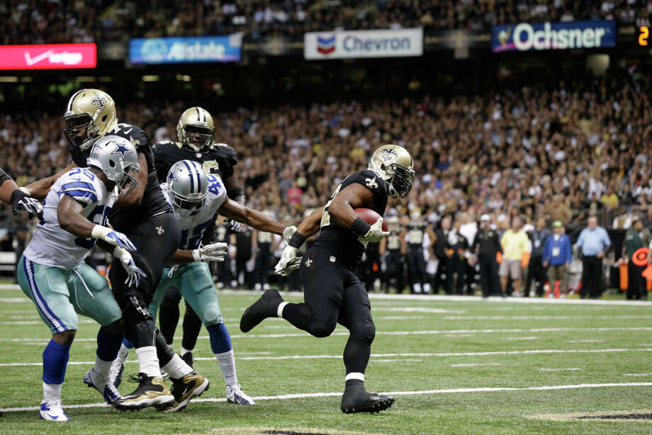New Orleans Saints running back Mark Ingram (22) carries into the end zone in front of Dallas Cowboys inside linebacker Ernie Sims (59) and free safety Barry Church (42) on a touchdown carry in the second half of an NFL football game in New Orleans, Sunday, Nov. 10, 2013. (AP Photo/Dave Martin) Photo: Dave Martin, Associated Press / AP