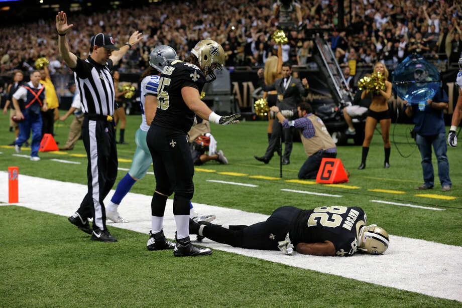 New Orleans Saints tight end Benjamin Watson (82) lies hurt after hitting his head on the turf on a pass play in the second half of an NFL football game against the Dallas Cowboys in New Orleans, Sunday, Nov. 10, 2013. (AP Photo/Bill Haber) Photo: Bill Haber, Associated Press / FR170136 AP