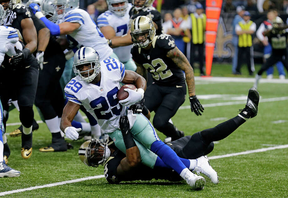 New Orleans Saints outside linebacker Ramon Humber tackles Dallas Cowboys running back DeMarco Murray (29) in the first half of an NFL football game in New Orleans, Sunday, Nov. 10, 2013. (AP Photo/Bill Haber) Photo: Bill Haber, Associated Press / FR170136 AP