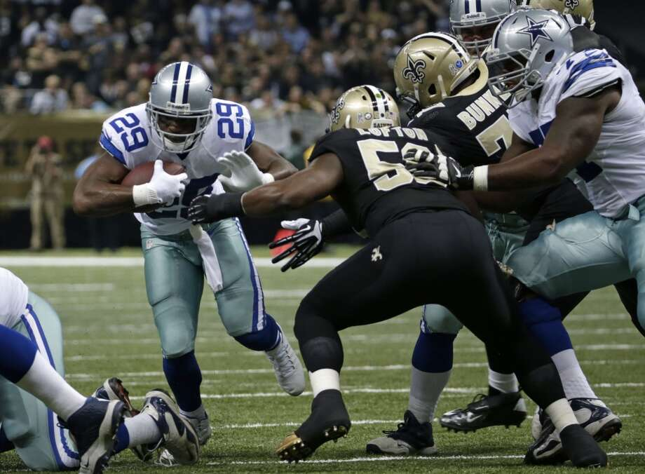 New Orleans Saints middle linebacker Curtis Lofton (50) tries to tackle Dallas Cowboys running back DeMarco Murray (29) in the first half of an NFL football game in New Orleans, Sunday, Nov. 10, 2013. (AP Photo/Dave Martin) Photo: Associated Press