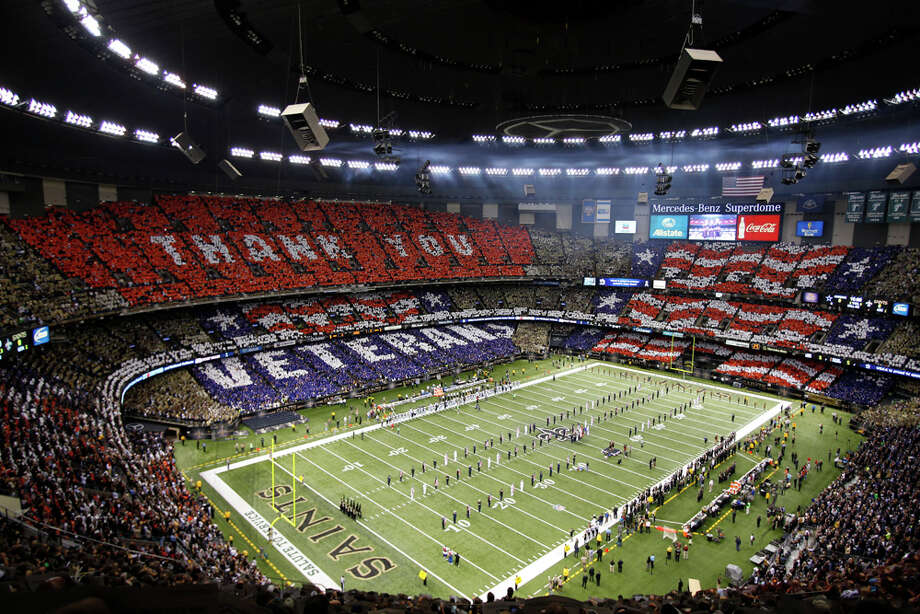 IN THIS IMAGE DISTRIBUTED BY AP IMAGES FOR USAA - An overall inside view of the Mercedes-Benz Superdome as fans honor military and veterans before an NFL game between the Dallas Cowboys and the New Orleans Saints, Sunday, November 10, 2013 in New Orleans. 50,000 cards were provided to fans by USAA, the official military appreciation sponsor of the NFL. (Kevin Terrell/AP Images for USAA) Photo: Kevin Terrell, Associated Press / AP