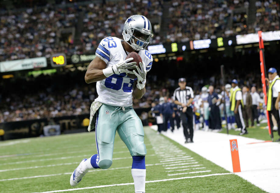 Dallas Cowboys wide receiver Terrance Williams (83) pulls in  a touchdown reception in the second half of an NFL football game against the New Orleans Saints in New Orleans, Sunday, Nov. 10, 2013. (AP Photo/Dave Martin) Photo: Dave Martin, Associated Press / AP