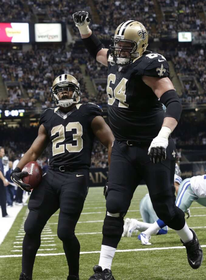 New Orleans Saints running back Pierre Thomas (23) crosses the goal with guard Brian Waters (64) on his touchdown carry in the first half of an NFL football game in New Orleans, Sunday, Nov. 10, 2013. (AP Photo/Dave Martin) Photo: Associated Press