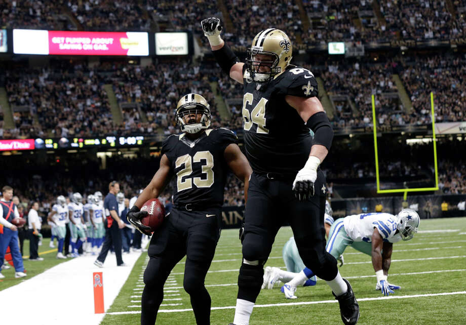 New Orleans Saints running back Pierre Thomas (23) crosses the goal line on a touchdown carry with tackle Zach Strief (64) in the first half of an NFL football game in New Orleans, Sunday, Nov. 10, 2013. (AP Photo/Dave Martin) Photo: Dave Martin, Associated Press / AP