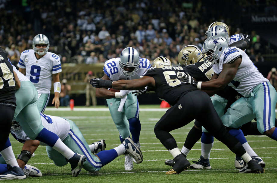 Dallas Cowboys running back DeMarco Murray (29) carries past New Orleans Saints middle linebacker Curtis Lofton (50) in the first half of an NFL football game in New Orleans, Sunday, Nov. 10, 2013. (AP Photo/Dave Martin) Photo: Dave Martin, Associated Press / AP