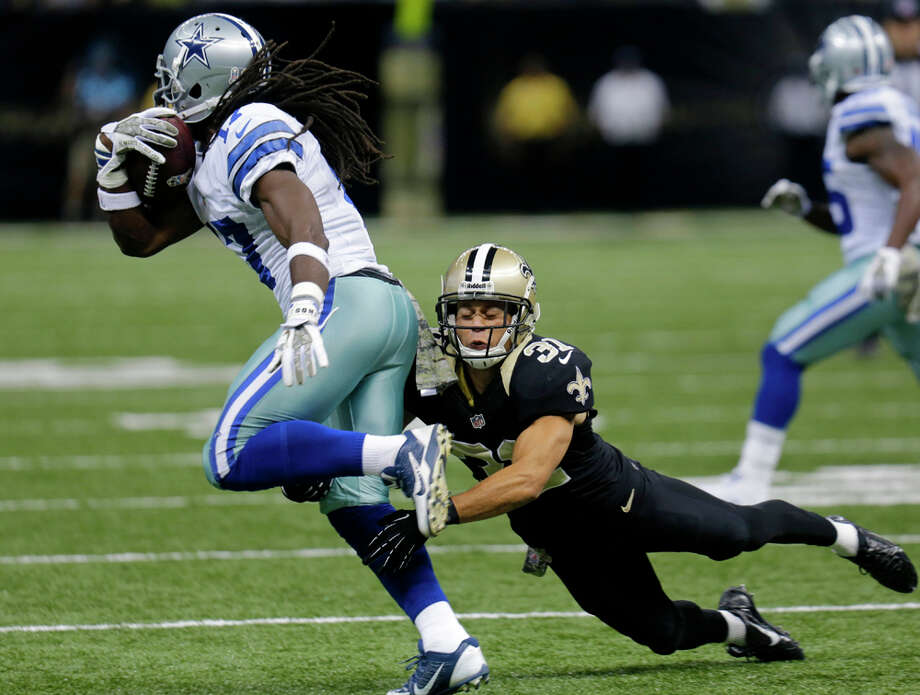 Dallas Cowboys wide receiver Dwayne Harris (17) runs past New Orleans Saints cornerback Chris Carr (31) in the first half of an NFL football game in New Orleans, Sunday, Nov. 10, 2013. (AP Photo/Bill Haber) Photo: Bill Haber, Associated Press / FR170136 AP