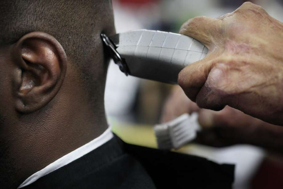 "Emory ""Em"" Waite works on Aaron Wilson's hair at ""The Em's Barber Shop"" in San Francisco, Calif. Photo: Mike Kepka, The Chronicle"