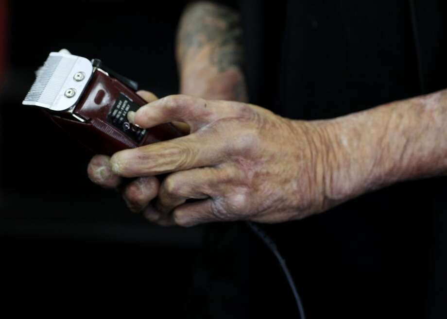 """Emory """"Em"""" Waite maintains a prized set of clippers in his shop """"The Em's Barber Shop"""" in San Francisco, Calif. Photo: Mike Kepka, The Chronicle"""