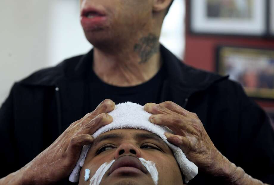 "Emory ""Em"" Waite prepares Jace Bell's head with a hot towel during the final touches of a cut in his shop ""The Em's Barber Shop"" in San Francisco, Calif. Photo: Mike Kepka, The Chronicle"