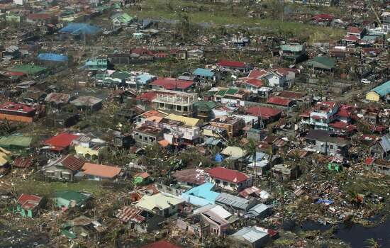 This photo released by the Malacanang Photo Bureau shows an aerial view of Tacloban city, Leyte province in central Philippines Sunday, Nov. 10, 2013, after Typhoon Haiyan ravaged the region in the Philippines. Haiyan, one of the most powerful storms on record, slammed into several central Philippine islands on Friday, leaving a wide swath of destruction and hundreds of people dead. Photo: Ryan Lim, AP / Malacanang Photo Bureau