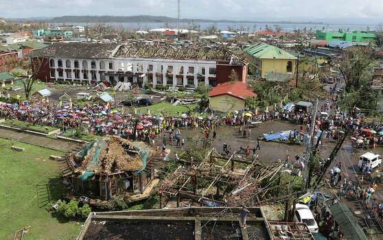 The devastation caused by Typhoon Haiyan, are seen Sunday, Nov. 10, 2013, in Tacloban city, Leyte province in central Philippines. Typhoon Haiyan, one of the most powerful storms on record, slammed into six central Philippine islands on Friday, leaving a wide swath of destruction and scores of people dead. Photo: Toti Navales, AP / AP