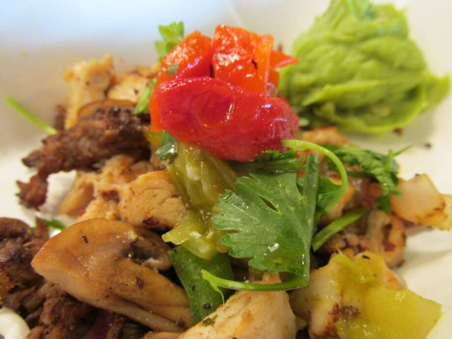 The Local topping at Pita Pit - sauteed chicken, beef, mushrooms and onions, topped with roasted red peppers, cilantro and green chiles with fresh avocado. Photo: Cat5