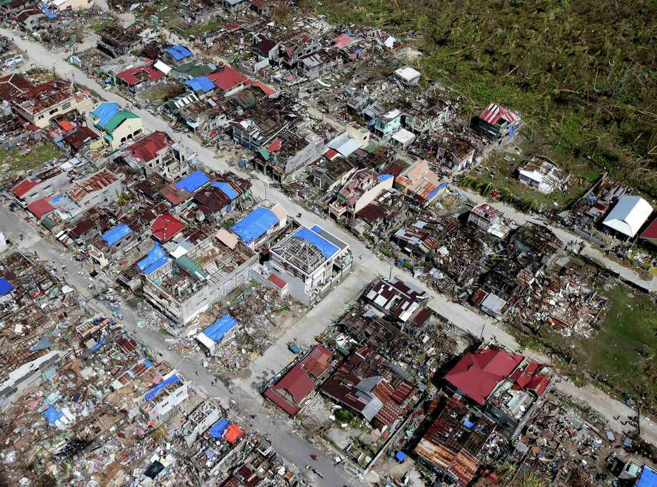 An aerial image taken from a Philippine Air Force helicopter shows the devastation of the first landfall by typhoon Haiyan, Monday Nov. 11, 2013  in Guiuan, Eastern Samar province, central Philippines. Authorities said at least 2 million people in 41 provinces had been affected by the Friday's disaster and at least 23,000 houses had been damaged or destroyed. Photo: Bullit Marquez, AP / AP
