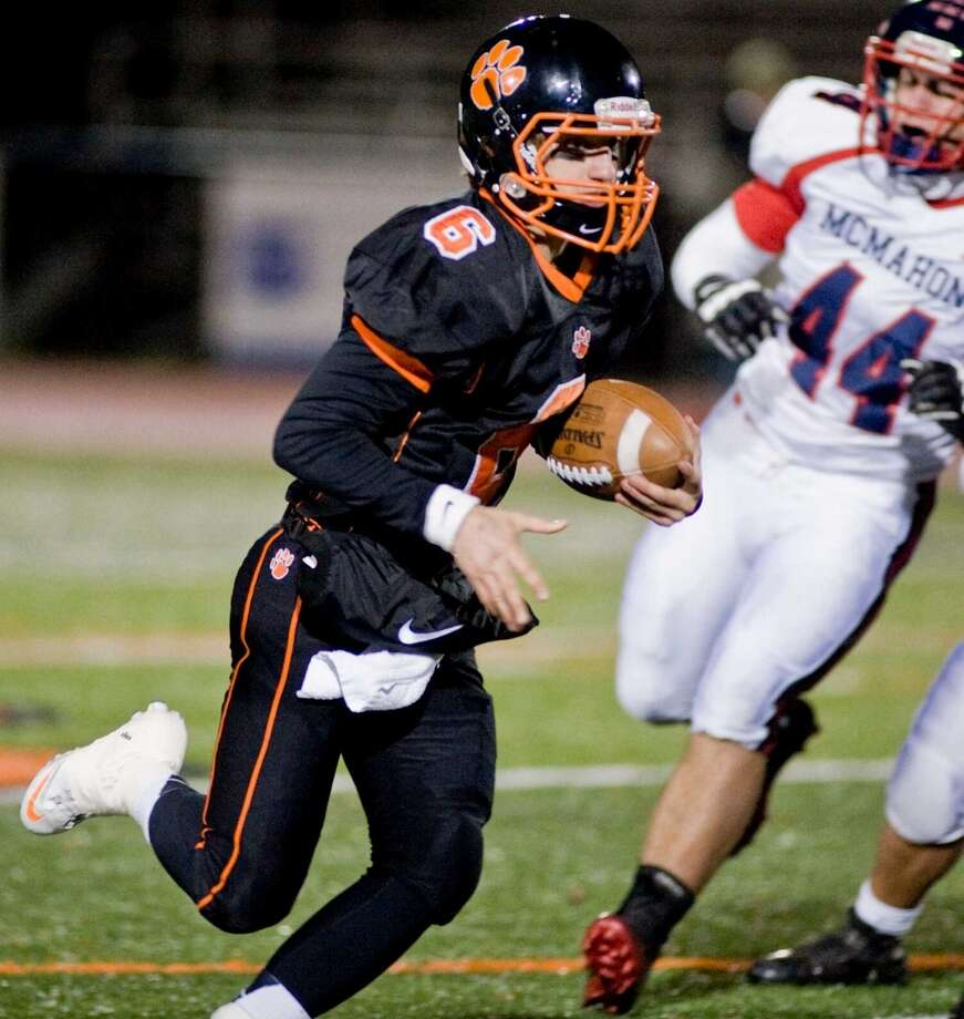 Ridgefield High School quarterback Ryan Dunn keeps the ball on a play against McMahon High School in the first quarter of a game at Ridgefield. Friday, Nov. 8, 2013 Photo: Scott Mullin