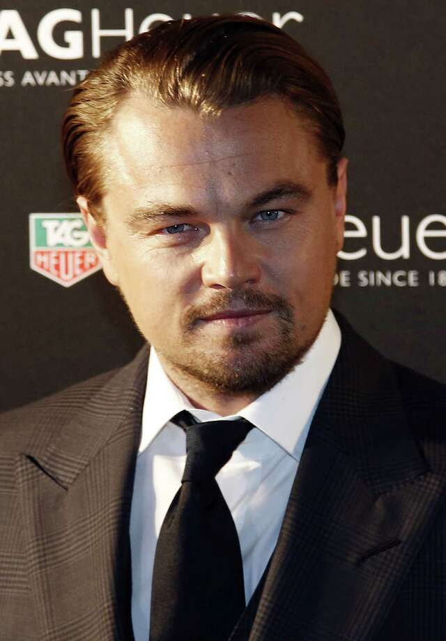 USA's actor Leonardo DiCaprio poses during a photocall at an evening event celebrating TAG Heuer's Carerra watch 50 years at the Pavillon Vendome in Paris, on November 6, 2013.  AFP PHOTO / LOIC VENANCEnLOIC VENANCE/AFP/Getty Images Photo: LOIC VENANCE / STF