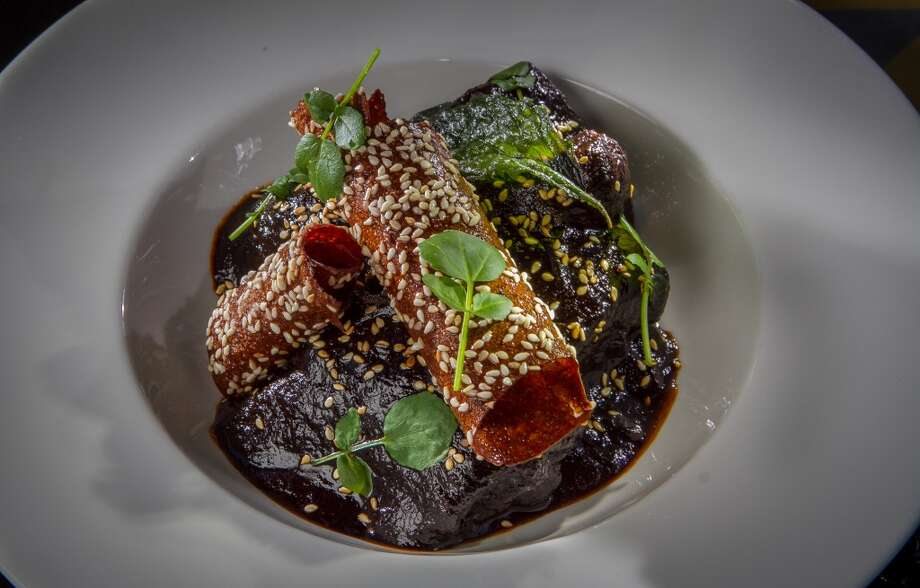 Roasted Chicken with Mole Negro sauce at La Urbana in San Francisco. Photo: John Storey, Special To The Chronicle