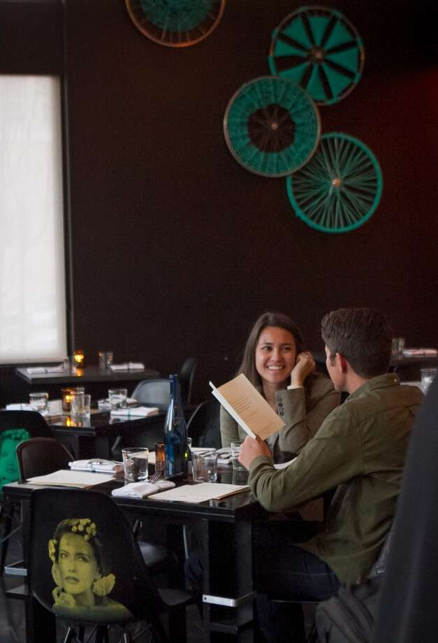 A couple enjoys dinner at La Urbana in San Francisco. Photo: John Storey, Special To The Chronicle