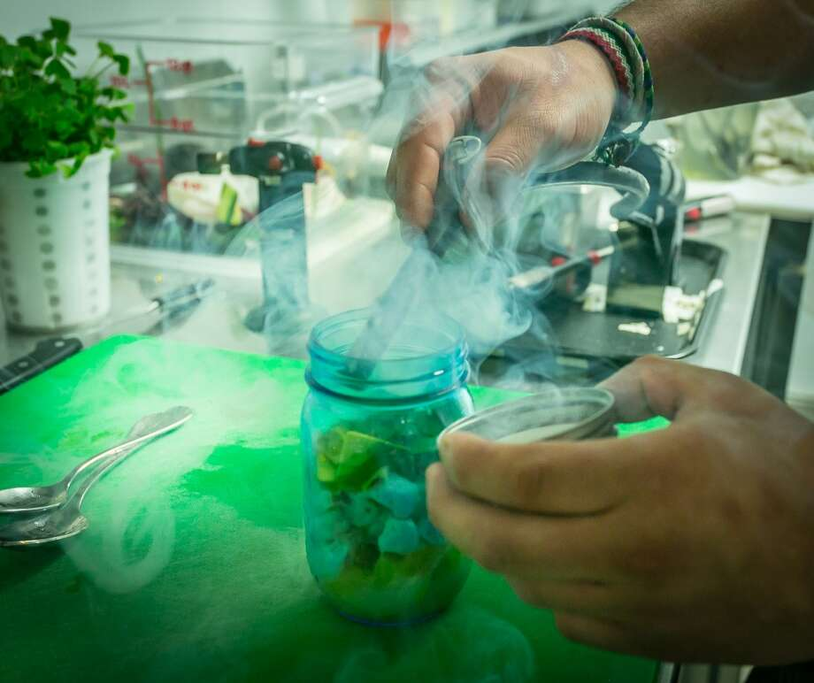 Smoke being added to the Aguachile Ceviche at La Urbana in San Francisco. Photo: John Storey, Special To The Chronicle