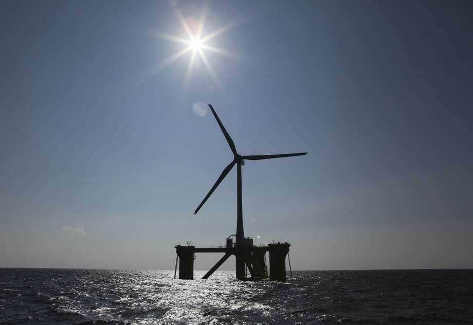 A wind turbine, named Fukushima Mirai, sits about 20 kilometers off the coast of Naraha, Fukushima Prefecture in northeastern Japan. Japan switched on the first turbine at the wind farm on Monday, Nov. 11, feeding electricity to the grid tethered to the tsunami-crippled nuclear plant onshore. Trading houses such as Marubeni Corp., which is leading the consortium building the offshore wind farm, are investing aggressively in renewable energy as well as conventional sources, helped by government policies aimed at nurturing favored industries. Photo: Koji Sasahara, AP