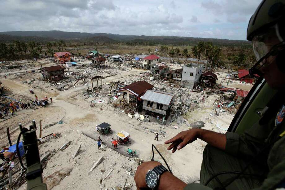 An aerial image taken from a Philippine Air Force helicopter shows the devastation caused by typhoon Haiyan,  Monday Nov. 11, 2013 in Hernani township, Eastern Samar province, central Philippines.  Authorities said at least 2 million people in 41 provinces had been affected by Friday's disaster and at least 23,000 houses had been damaged or destroyed. Photo: Bullit Marquez, AP / AP