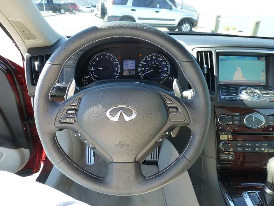 Once you're in the car, you'll find a straightforward dashboard, with the requisite navigation/rear-view camera screen in the center stack and the stick for the seven-speed automatic transmission on the center console, where it belongs.