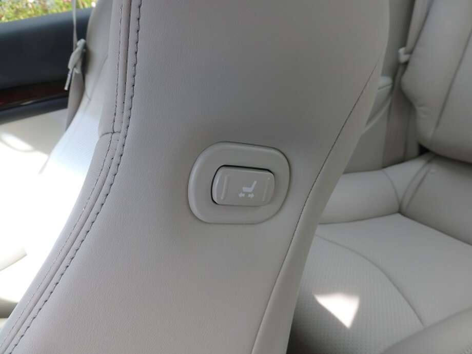 A button on the left side of the front passenger's seat back  allows the driver to move the passenger seat forward so someone can clamber into the back seat.
