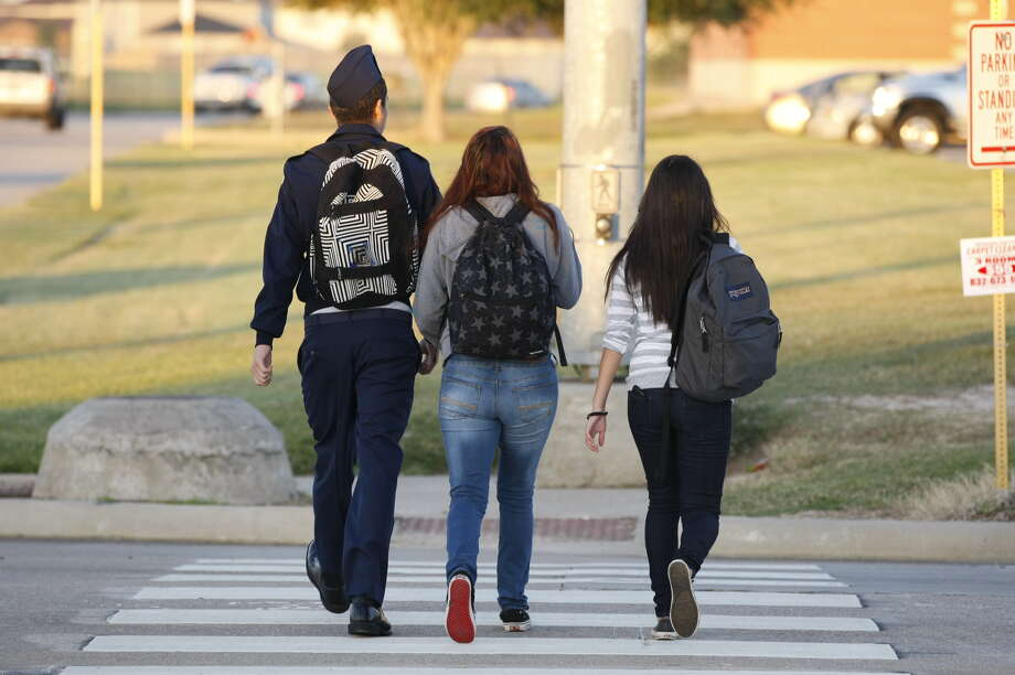 Students head to school at Cy-Springs High School Monday morning. Photo: Johnny Hanson, Houston Chronicle