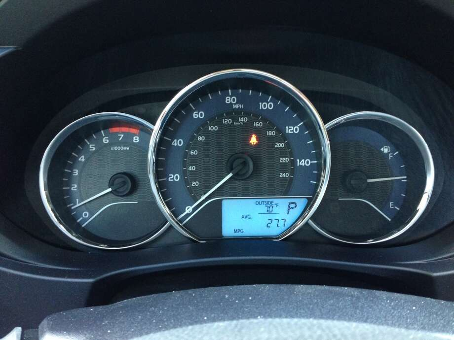 The LCD screen is the tripmeter, showing mileage and MPG data. Photo: Dwight Silverman, Houston Chronicle