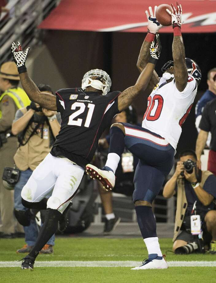 Texans wide receiver Andre Johnson catches a 5-yard touchdown pass as Cardinals cornerback Patrick Peterson (21) defends during the fourth quarter. Photo: Smiley N. Pool, Houston Chronicle