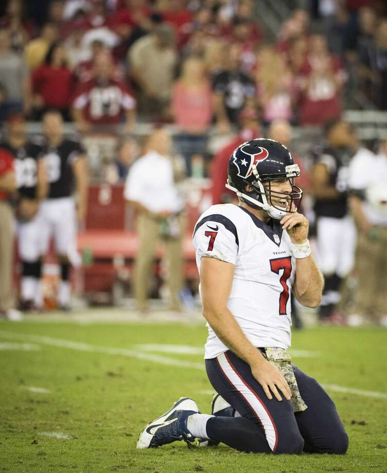 Texans quarterback Case Keenum is slow to get up after throwing an incomplete pass to force a punt during the second half. Photo: Smiley N. Pool, Houston Chronicle