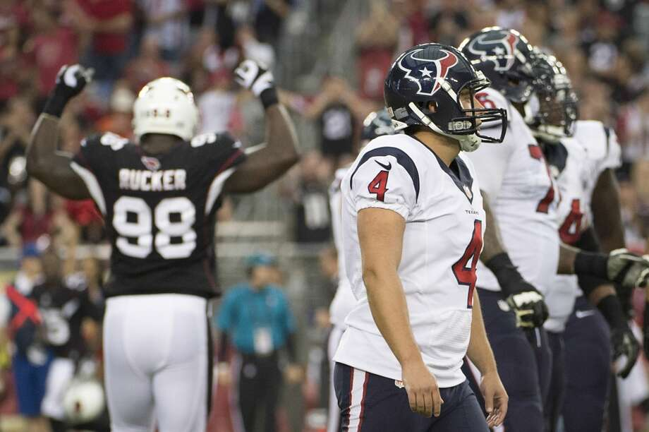 Texans kicker Randy Bullock reacts after Cardinals cornerback Justin Bethel blocked his 40-yard field-goal try near the end of the first half. The kick became Bullock's ninth miss of the season, the most by any kicker in the NFL. Photo: Smiley N. Pool, Houston Chronicle