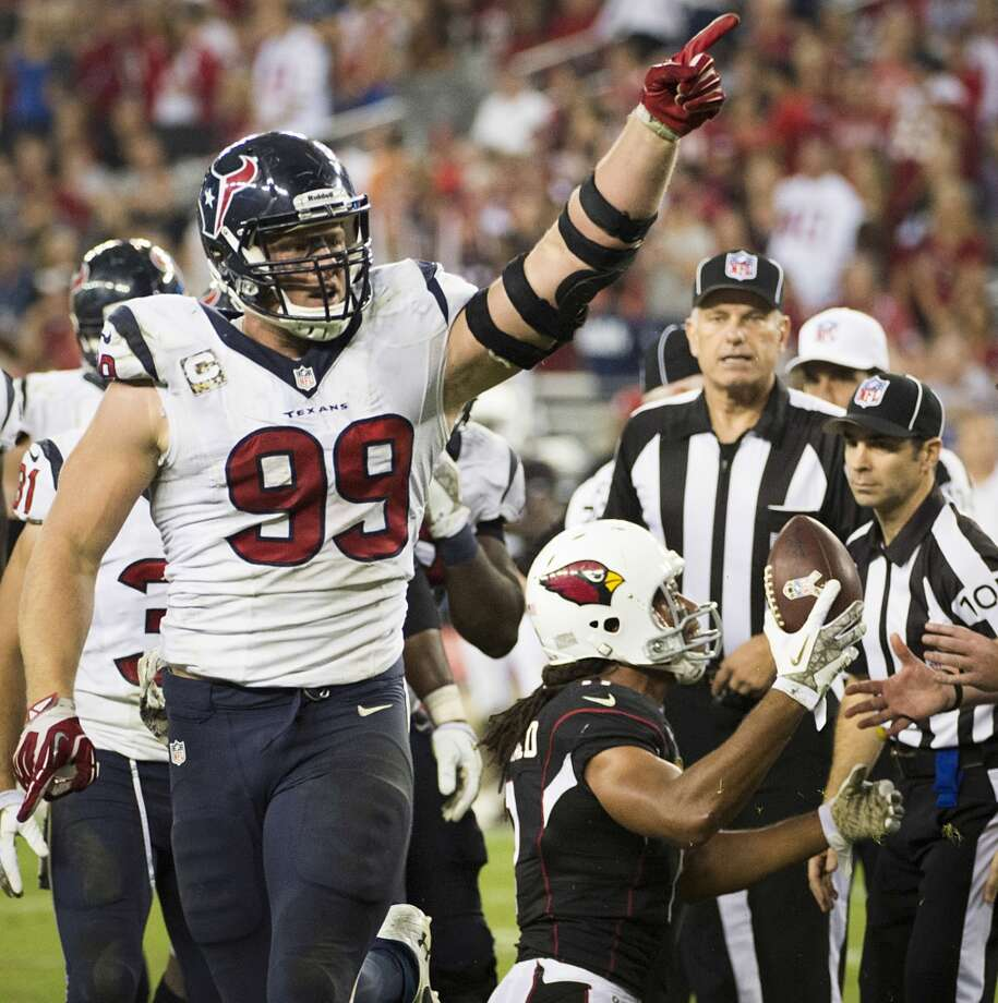 Texans defensive end J.J. Watt celebrates after recovering a fumble during the second half. Photo: Smiley N. Pool, Houston Chronicle