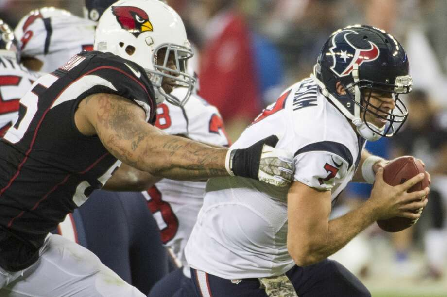 Texans quarterback Case Keenum is sacked by Cardinals outside linebacker John Abraham. Photo: Smiley N. Pool, Houston Chronicle