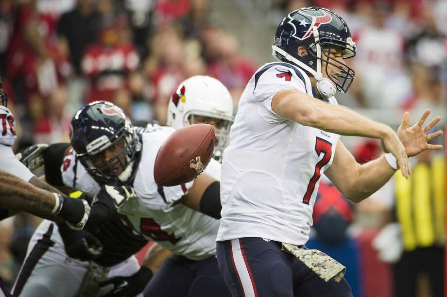 Texans quarterback Case Keenum fumbles as he tries to pass on the opening drive of the game. Photo: Smiley N. Pool, Houston Chronicle