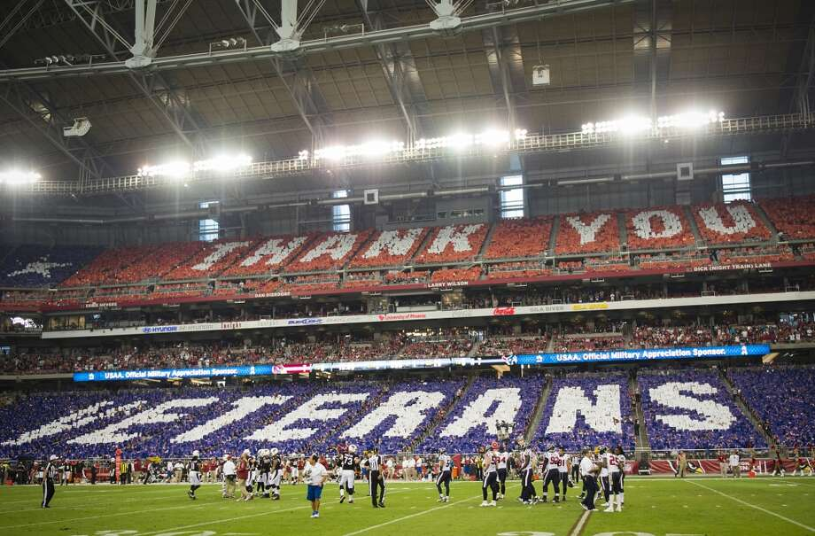 "Fans perform a card stunt to spell out ""Thank You Veterans"" during the first half. Photo: Smiley N. Pool, Houston Chronicle"