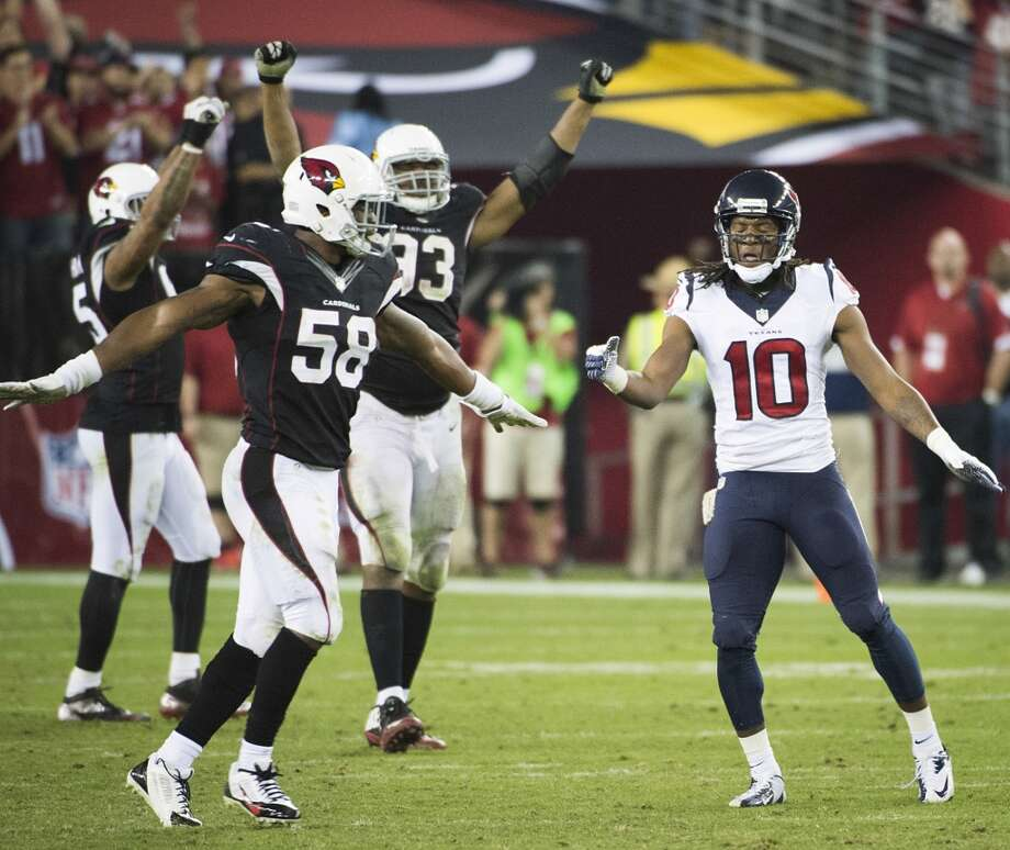 Cardinals linebacker Daryl Washington (58) and defensive end Calais Campbell (93) celebrate after a fourth down pass to Texans wide receiver DeAndre Hopkins (10) fell incomplete during the fourth quarter. Photo: Smiley N. Pool, Houston Chronicle