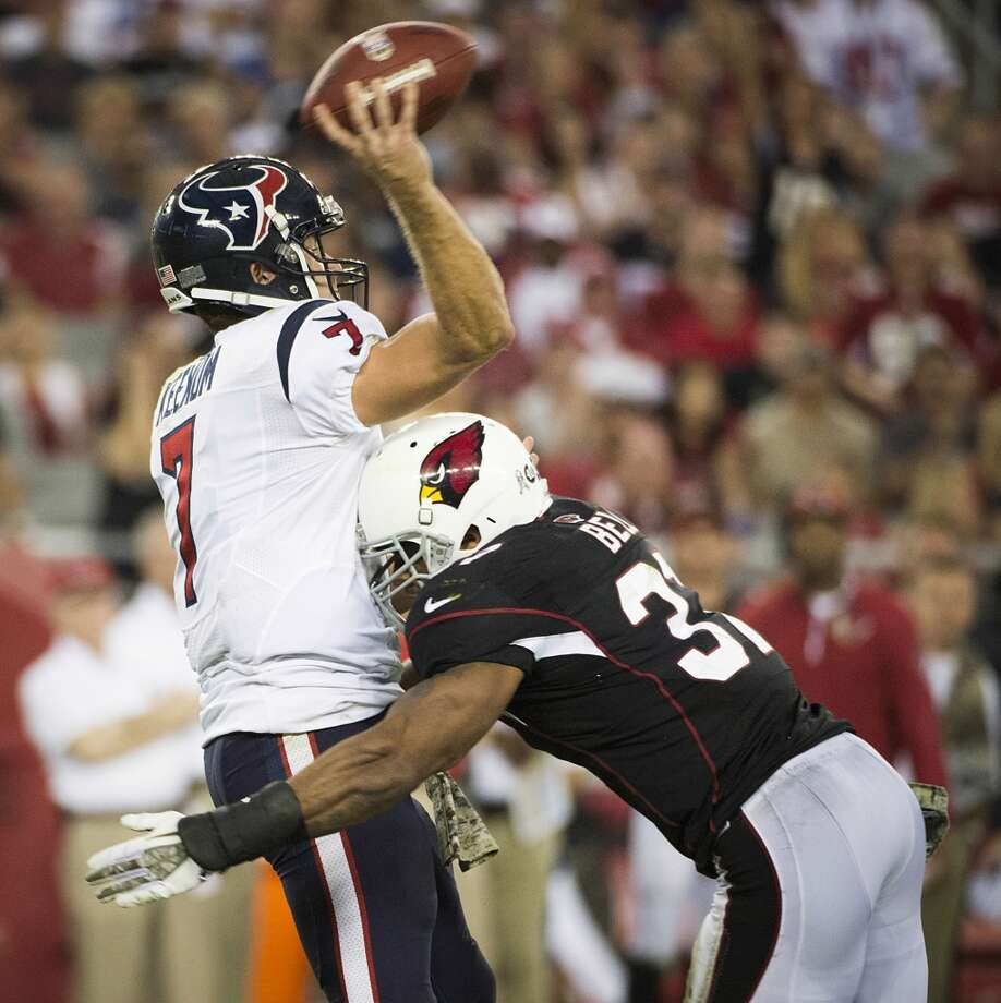 Texans quarterback Case Keenum gets off a pass as he is hit by Cardinals cornerback Justin Bethel. Photo: Smiley N. Pool, Houston Chronicle