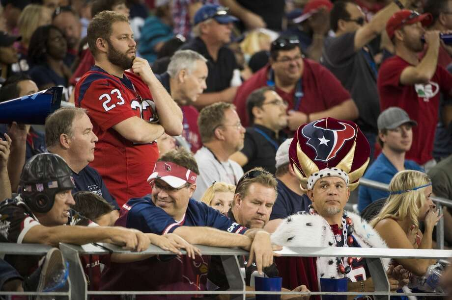 Texans fans react during the second half. Photo: Smiley N. Pool, Houston Chronicle