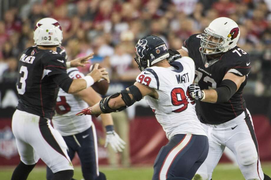 Cardinals quarterback Carson Palmer (3) gets off a pass as tackle Eric Winston (73) blocks Texans defensive end J.J. Watt. Photo: Smiley N. Pool, Houston Chronicle