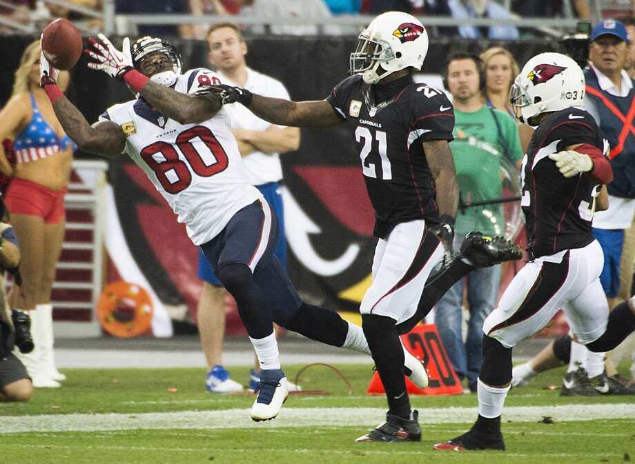 Texans wide receiver Andre Johnson can't hold on to a pass as Cardinals cornerback Patrick Peterson defends. Photo: Smiley N. Pool, Houston Chronicle