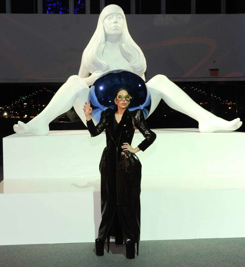 Lady Gaga unveils a sculpture of herself by artist Jeff Koons during the ARTPOP album release and artRave event at the Brooklyn Navy Yard on Sunday, Nov. 10, 2013 in New York City. (Photo by Evan Agostini/Invision/AP) ORG XMIT: NYEA118 Photo: Evan Agostini, AP / Invision