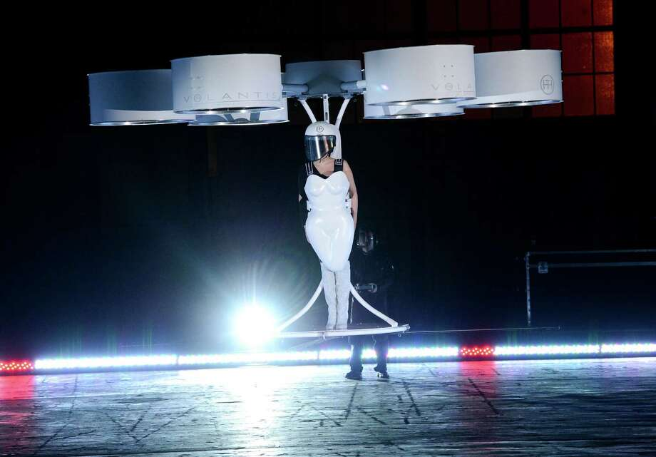 "Lady Gaga demonstrates the Volantis transport prototype ""flying dress"" designed by TechHaus - Studio XO during the ARTPOP album release and artRave event at the Brooklyn Navy Yard on Sunday, Nov. 10, 2013 in New York City. (Photo by Evan Agostini/Invision/AP) ORG XMIT: NYEA106 Photo: Evan Agostini, AP / Invision"