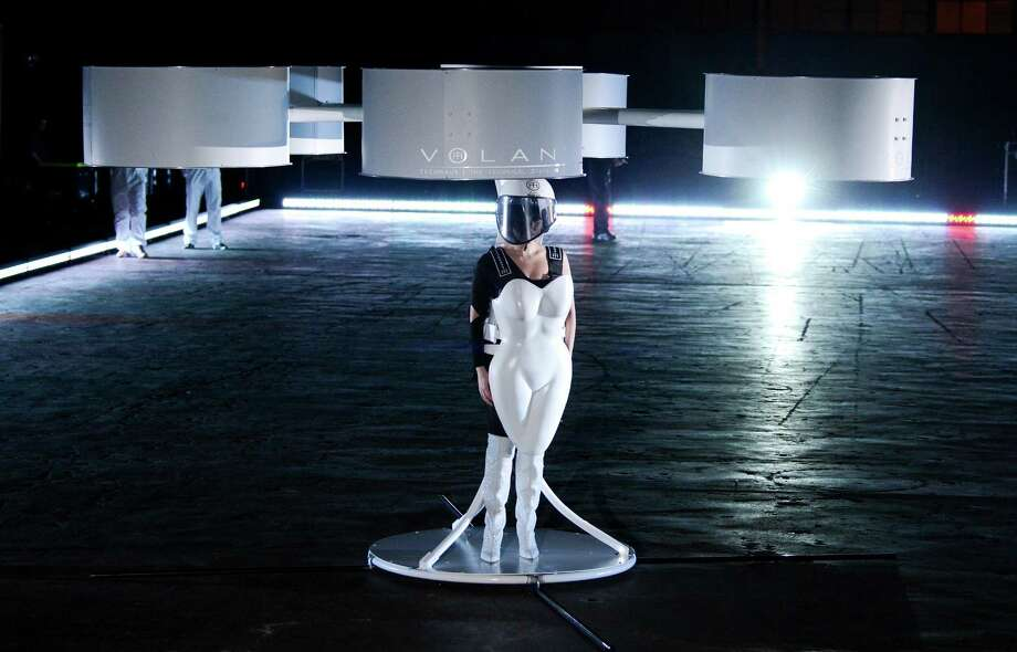 "Lady Gaga demonstrates the Volantis transport prototype ""flying dress"" designed by TechHaus - Studio XO during the ARTPOP album release and artRave event at the Brooklyn Navy Yard on Sunday, Nov. 10, 2013 in New York City. (Photo by Evan Agostini/Invision/AP) ORG XMIT: NYEA109 Photo: Evan Agostini, AP / Invision"